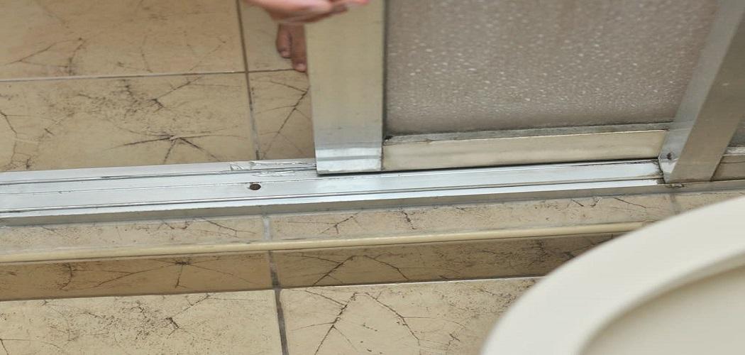 Fix a Sliding Shower Door Bottom Sill Guide